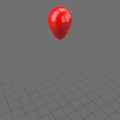 Red balloon with a string
