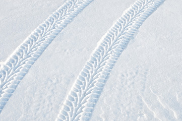 Car tire tracks in fresh snow