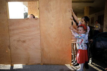 Ultra-Orthodox Jewish children build a ritual booth, known as a sukkah in Ashdod