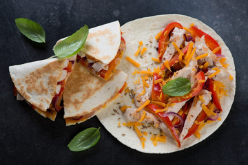 Quesadilla with grilled chicken meat, vegetables and cheddar cheese, horizontal shot, elevated view