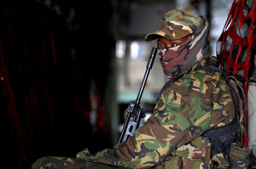 A member of Botswana Defence Force (BDF) looks on ahead of taking off in a military aircraft in Maun
