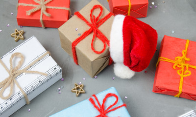 Christmas gifts and Santa's red hat.New year, winter holiday.