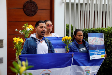 Demonstrators stand outside the Nicaraguan embassy to protest against President Daniel Ortega's government in Lima