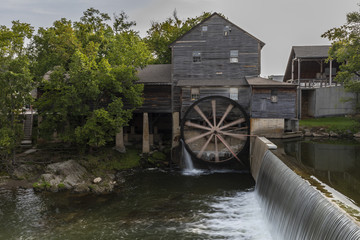 Fotobehang Molens Old Grist Mill with Water Wheel and Dam