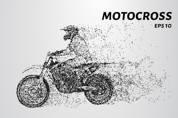 Motorcyclists at the start of the race. Motocross from particles
