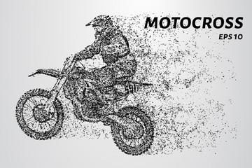 Rider on a motorcycle involved in motocross.Jumps and takes off on a springboard.