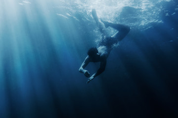 Man snorkeling underwater.