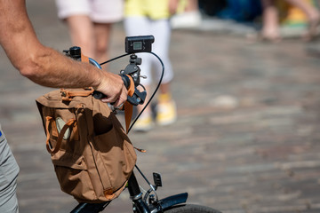 A cyclist is filming with a video camera attached to a steering wheel.