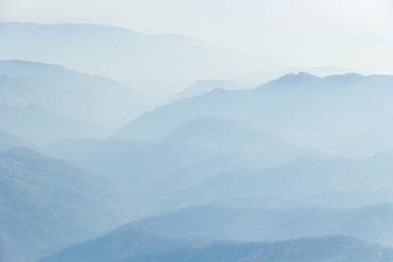 Infinite Blue /Dream Valleys. A mood picture where the misty thin veil defines the hills and valley