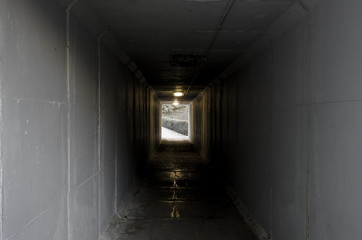 Cement tunnel with light at the end