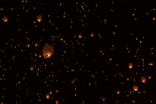 Low angle view of illuminated paper lanterns flying against sky at night during Chinese New Year