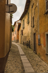 Empty alley amidst buildings at Lake Maggiore