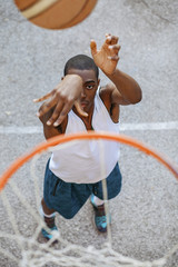 High angle view of basketball player making basket while standing at court