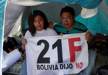 "Opposition activists holds a sign that reads ""21F, Bolivia say No"" for the February 21 referendum, during a hunger strike against President Evo Morales' bid for re-election in 2019, in La Paz"