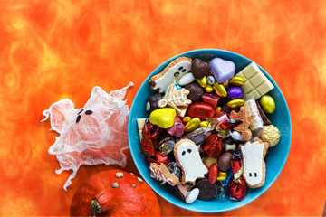 Happy Halloween card. Funny delicious ginger cookie shape ghost and skeleton, Halloween Jack o Lantern candy bowl