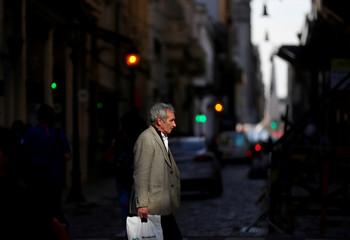 A man walks the street near the Casa Rosada Presidential Palace in Buenos Aires