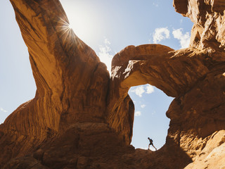 Side view of hiker walking on rock formation at Canyonlands National Park