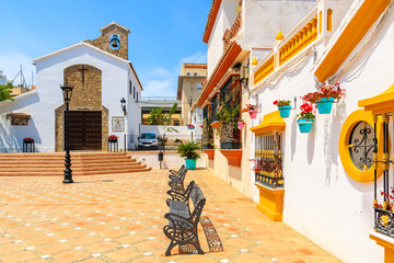 Typical white church building on square in Estepona town, Costa del Sol, Spain