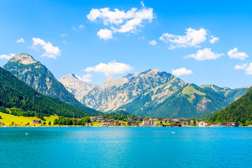 View of Pertisau village on shore of beautiful Achensee lake on sunny summer day, Tirol Wall mural