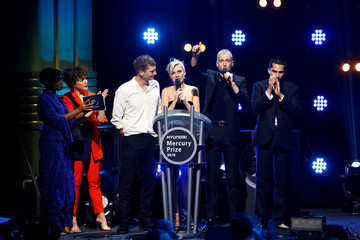 Members of the band Wolf Alice speak onstage after being announced winners of the Mercury Prize 2018 at the Hammersmith Apollo in London