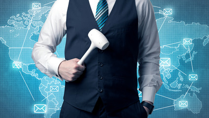 Businessman holding tool with global map graphic on the background