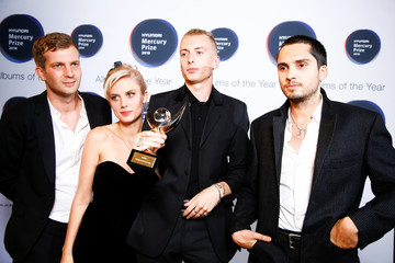 Members of the band Wolf Alice pose with an award after being announced winners of the Mercury Prize 2018 at the Hammersmith Apollo in London