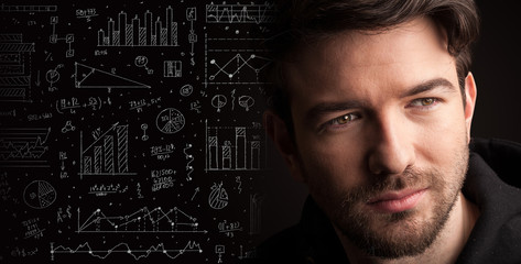 Portrait of a young businessman with charts and graphs scribbled next to him on a dark background