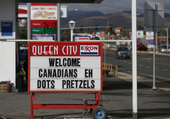 A gas station sign welcomes Canadians in Helena, Montana
