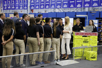 White House Senior Advisor Trump and U.S. Senator Cruz (R-TX) meet with local high school students involved in robotics competitions during a tour of the Johnson Space Center in Houston