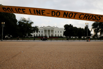 A police line closes off Pennsylvania Avenue in front of the White House in Washington