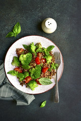 Buckwheat detox salad with broccoli and tomato.Top view with copy space.