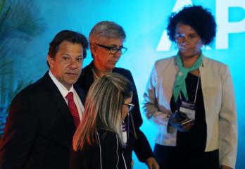 Presidential candidate Fernando Haddad (L) arrives to attend a televised debate in Aparecida do Norte