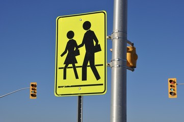 School children crossing sign posted on the intersection