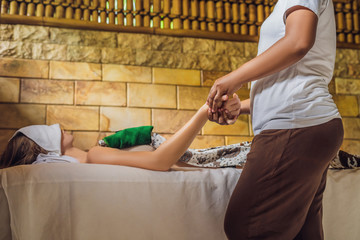 Total relaxation. Beautiful Young Wwoman Get Balinese or Thai Massage
