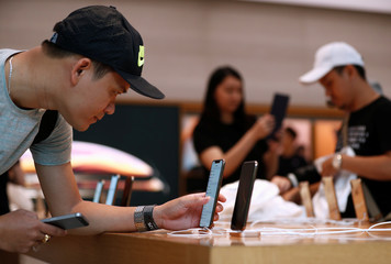 A customer looks at the newly launched iPhone XS at the Apple Store in Singapore