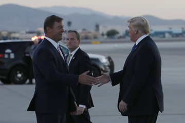 U.S. President Trump is greeted by U.S. Senator Heller as he arrives for a campaign rally at the airport in Las Vegas