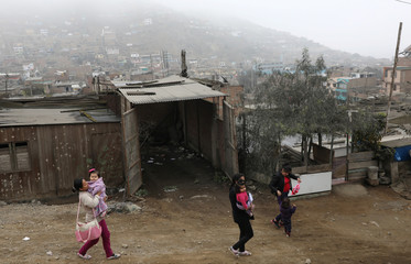Mothers and children leave after taking part in an early stimulation workshop in Lima