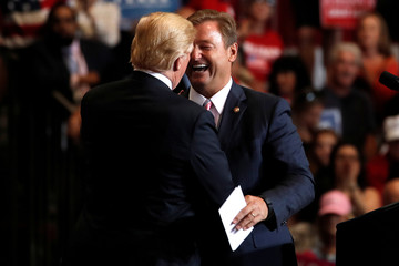 U.S. President Donald Trump and Senator Dean Heller (R-NV) embrace at a campaign rally in Las Vegas