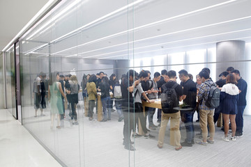 People handle the new Apple iPhone XS and iPhone XS Max during a media tour at an Apple office in Shanghai,
