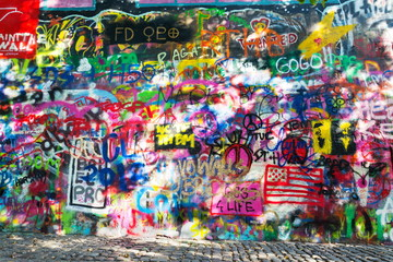 Famous John Lennon Wall covered with graffiti in the Little Town area near Charles Bridge, Mala Strana, Prague, Czech Republic