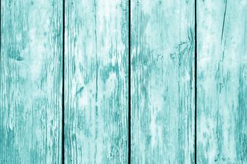 Old grunge wooden fence pattern in cyan tone.