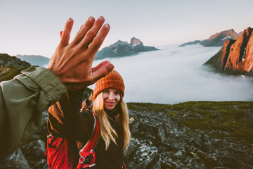 Travel couple friends giving five hands outdoor hiking in mountains adventure lifestyle positive emotions concept family together on journey vacations