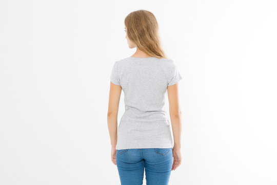 Woman in template blank t shirt isolated on white background. Back view. Mock up. Copy space.