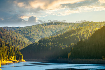 storage lake reservoir in mountain. beautiful autumn landscape at sunrise