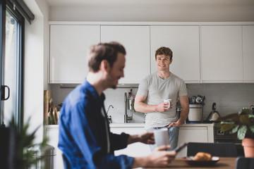 Roommates having breakfast together