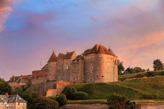 Beautiful view of Ch?teau de Dieppe at sunset in Normandy, France, with a vibrant sunset sky