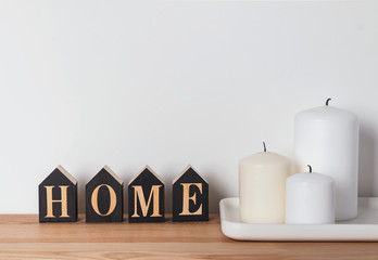 Home concept with candles and wooden letters