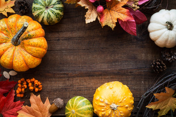 Autumnal frame with pumpkins, fall leaves and fruits. Fall harvest. Thanksgiving concept for greeting card with copyspace