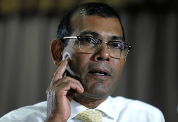 Maldives former President Nasheed reacts during a news conference ahead of the Maldives presidential election, in Colombo