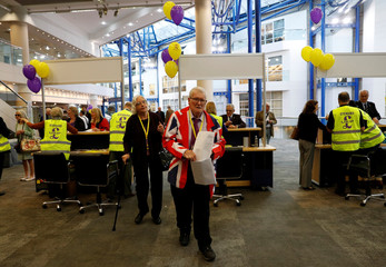 A delegate arrives for the UKIP party conference in Birmingham